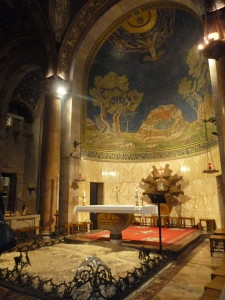 Inside the Church of All Nations during Holy Hour. The slab of stone is where Jesus prayed on that night.